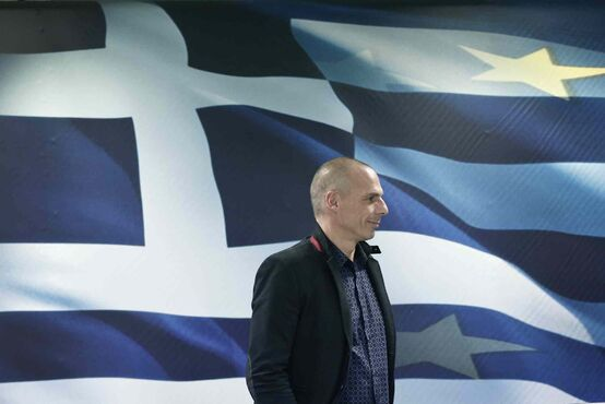 Greece's new Finance Minister Yanis Varoufakis arrives for a handover ceremony at the Finance Ministry in Athens, Wednesday. Greece's radical new government on Wednesday signalled the country would backtrack or scrap a series of budget measures its eurozone creditor nations had demanded in exchange for bailout loans.