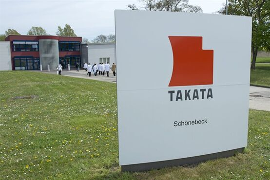 FILE - In this Thursday, April 17, 2014, file photo, journalists visit Takata Ignition Systems in Schoenebeck, Germany. U.S. safety regulators are threatening fines and legal action against Takata Corp. for failing to admit that its driver's-side air bag inflators are defective and should be recalled nationwide. The National Highway Traffic Safety Administration sent a letter to the company Wednesday, Nov. 26, 2014, detailing the threats, which include a public hearing and possible court action. (AP Photo/Jens Meyer, File)