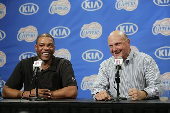 FILE - In this Aug. 18, 2014, file photo, new Los Angeles Clippers owner Steve Ballmer, right, and head coach Doc Rivers share a laughter during a news conference held after the Clippers Fan Festival in Los Angeles. Rivers is staying with the Los Angeles Clippers for another five years. In Ballmer's first big move since taking over as the team's new owner last week, he has locked in Rivers through the 2019 season. Ballmer said Wednesday, Aug. 27, 2014, it was one of his top priorities to ensure that Rivers remains as the long-term leader of the team. (AP Photo/Jae C. Hong, File)