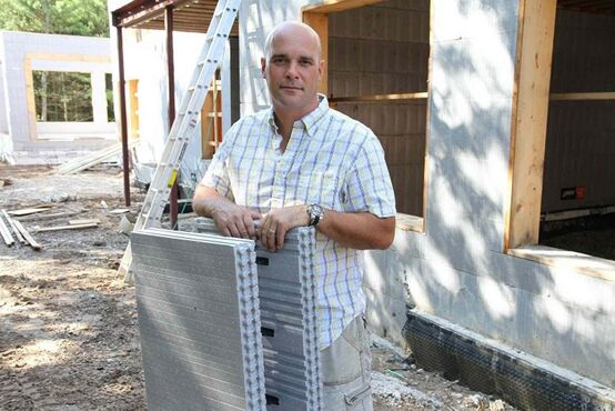 Star of HGTV Canada's House of Bryan series and Ontario-based contractor Bryan Baeumler shows an insulated concrete form made by AMC Foam Technologies in the RM of Headingley.