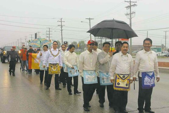 Rain did not hinder the Fil-Can Masons joining the third Manitoba Filipino Street Festival parade on Aug. 23.