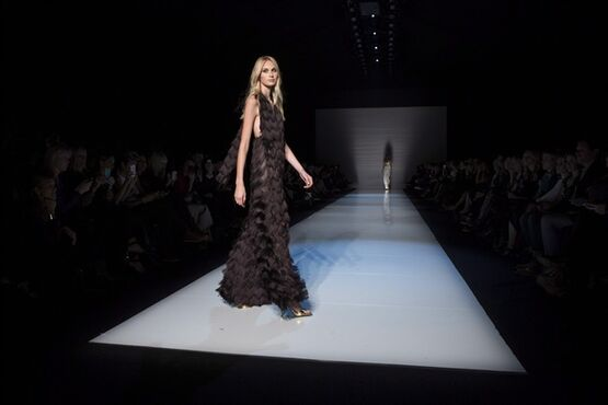 A model shows a creation from Pink Tartan while walking the runway during Toronto Fashion Week in Toronto on Monday, October 20, 2014. THE CANADIAN PRESS/Chris Young
