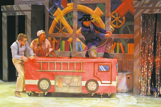 Professor Pim (Darren Martens), hippie Patsy (Andrea Houssin) and fireman Fullerton (Aaron Hutton) in Munsch Upon a Time at Prairie Theatre Exchange.