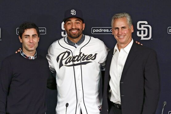 San Diego Padres outfielder Matt Kemp, center, poses for a picture with Padres general manager A.J. Preller, left, and manager Bud Black, right, during a news conference introducing Kemp as part of the baseball club Friday, Dec. 19, 2014, in San Diego. The Padres deal for the former the Los Angeles Dodger was the first of three big deals by the new Padres general manager, who also has added outfielder Wil Myers, the 2013 AL Rookie of the Year, from Tampa Bay and All-Star catcher Derek Norris from Oakland. (AP Photo/Gregory Bull)