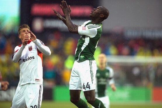 Pa-Modou Kah, right, of the Portland Timbers looks for the ball against DC United in Portland on May 3, 2014. THE CANADIAN PRESS/AP, The Oregonian, Jamie Francis