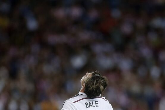 Real Madrid Gareth Bale, reacts during a Spanish Super Cup soccer match against Atletico Madrid at the Vicente Calderon stadium in Madrid, Spain, Friday, Aug. 22, 2014 . (AP Photo/Daniel Ochoa de Olza)