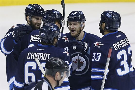 Winnipeg Jets' Andrew Ladd (16), Blake Wheeler (26), Ben Chiarot (63), Bryan Little (18) and Dustin Byfuglien (33) celebrate Wheeler's goal as the Columbus Blue Jackets' David Savard (58) skates past during first period NHL action in Winnipeg on Wednesday, January 21, 2015. Four Canadian teams are in playoff positions at the NHL's all-star break. The Montreal Canadiens are the lone Eastern Conference team, while the Jets, Vancouver Canucks and Calgary Flames are in the top eight in the West.THE CANADIAN PRESS/John Woods