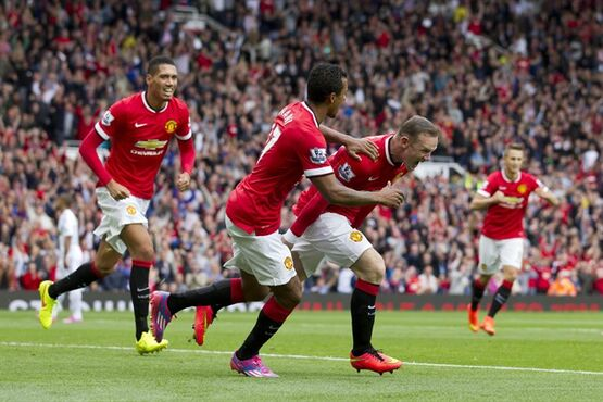 Manchester United's Wayne Rooney, centre right, celebrates with teammates after scoring against Swansea City during their English Premier League soccer match at Old Trafford Stadium, Manchester, England, Saturday Aug. 16, 2014. (AP Photo/Jon Super)