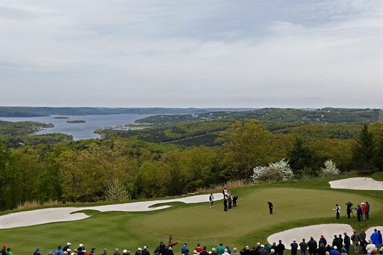 Gary Player sinks a putt in the third green of the Top of the Rock golf course during the Champions Tour's Bass Pro Shops Legends of Golf tournament in Ridgedale, Mo., Friday, April 24, 2015. (Guillermo Hernandez Martinez/The Springfield News-Leader via AP) NO SALES