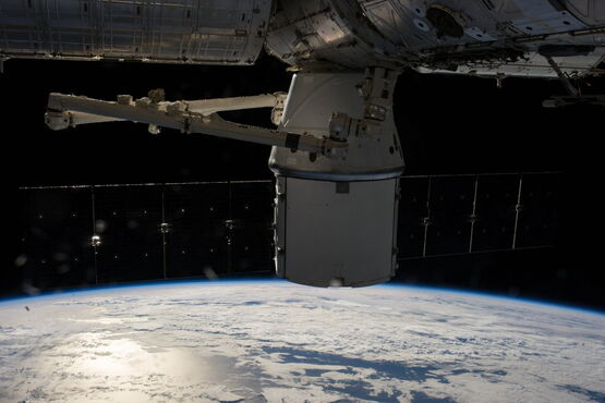 In this photo provided by NASA, the SpaceX Dragon capsule is berthed at the International Space Station Sunday as photographed by the Expedition 39 crew members on board the orbital outpost. Two NASA astronauts aboard the International Space Station will conduct a spacewalk Wednesday to replace a failed backup computer relay system on the space station's truss.