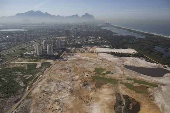 FILE - This June 27, 2014 file photo shows an aerial view of the Rio 2016 Olympic golf course under construction in Rio de Janeiro, Brazil. Construction work on the golf course for the 2016 Olympics could be halted under a filing made by state prosecutors suing the city of Rio de Janeiro and the developer over environmental rules. In a legal brief made public late Wednesday, Nov. 19, 2014, prosecutors termed