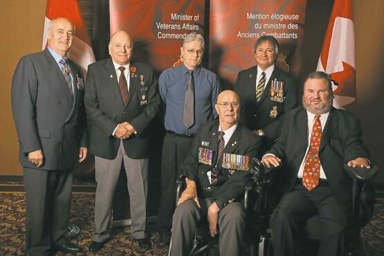 (From left) Minister of Veterans Affairs Julian Fantino with Minister of Veterans Affairs Commendation recipients Barry Mitchell of Winnipeg, George W. Stetina of Winnipeg, Gordon Criggar of Headingley, and Clinton Fontaine of Winnipeg, joined by MP Steven Fletcher (Charleswood-St. James-Assiniboia-Headingley). The  commendations were presented at a ceremony in Winnipeg on Oct. 10.