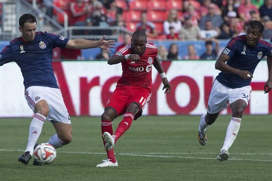 Toronto FC 's Jackson (centre) scores his team's first goal against Chivas USA during first half MLS action in Toronto on Sunday September 21, 2014. THE CANADIAN PRESS/Chris Young