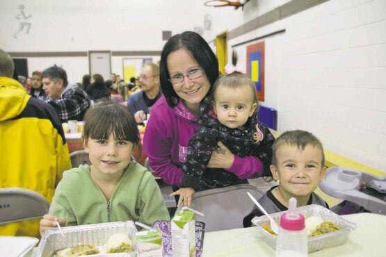 Nicole Pearson and her kids were happy to dig in to this Thanksgiving feast at Machray School