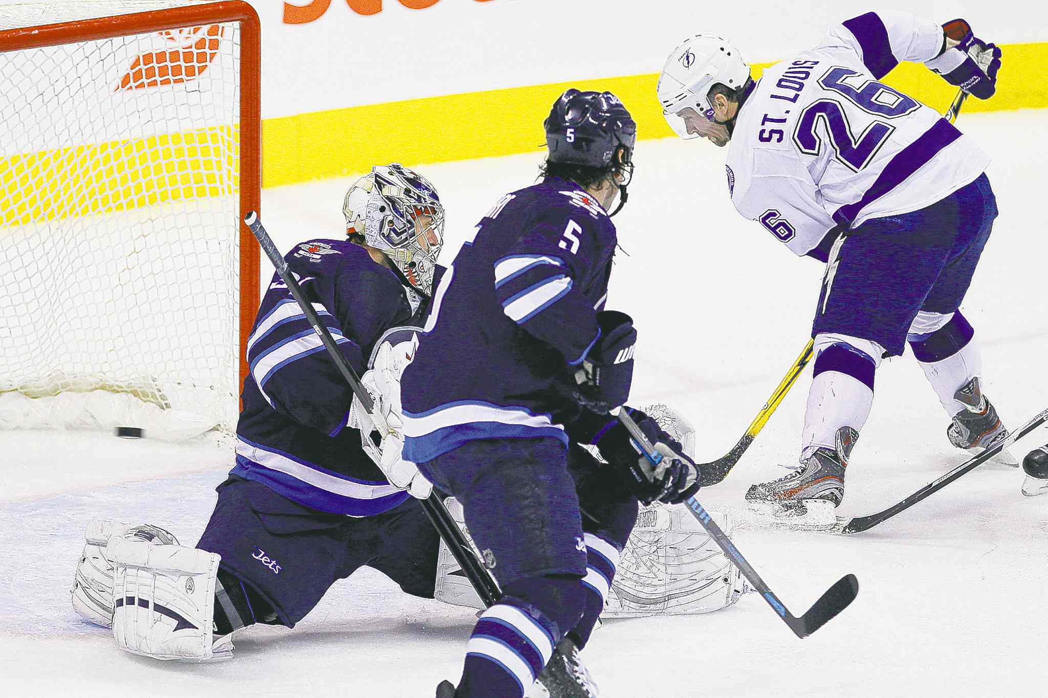 Tampa Bay's Martin St. Louis (26) slipped past the Jets' defence to score the game-winning goal Tuesday night at the MTS Centre.