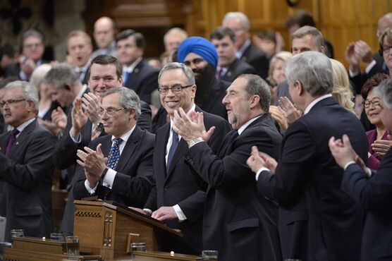 Finance Minister Joe Oliver receives applause before tabling the federal budget in the House of Commons in Ottawa on Tuesday, April 21, 2015. THE CANADIAN PRESS/Adrian Wyld