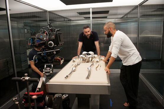 """In this image released by A24 Films, Oscar Isaac, right, appears on the set with filmmaker Alex Garland during the making of the science fiction film """"Ex-Machina."""" The film opens in theaters April 10, was made for $15 million. (AP Photo/A24 Films)"""