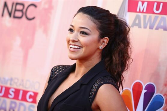 FILE - In this Sunday, March 29, 2015, file photo, Gina Rodriguez arrives at the iHeartRadio Music Awards at The Shrine Auditorium on , in Los Angeles.