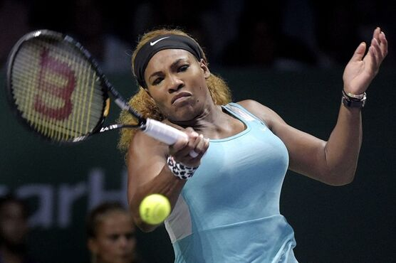 Serena Williams of the U.S. returns a shot against Ana Ivanovic of Serbia during their singles tennis match at the WTA Finals in Singapore, Monday, Oct. 20, 2014. Williams won her opening match at the WTA Finals on Monday, beating Ivanovic 6-4, 6-4 in the Red Group for her 16th consecutive victory at the season-ending tournament. (AP Photo/ Joseph Nair)