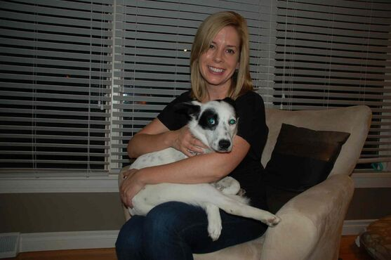 East Kildonan resident Kareena Grywinski holds rescue dog Hope at her home.
