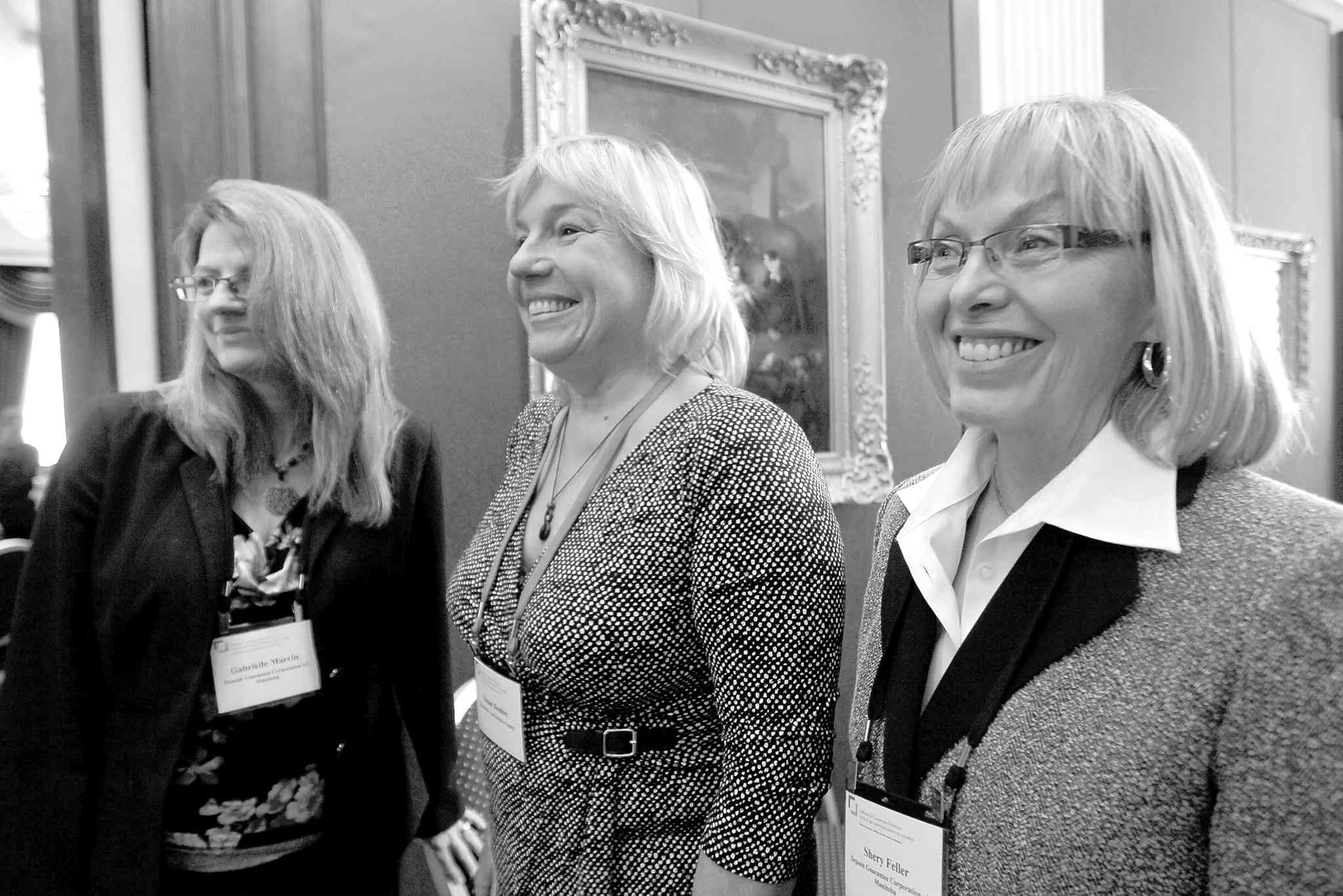 Gabrielle Marrin (left) and Shery Feller (right) of the Deposit Guarantee Corporation of Manitoba are joined by Susan Boulter, director of Manitoba's Vital Statistics Agency, at a luncheon Wednesday.