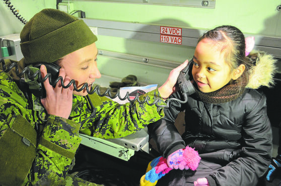 "Mathieu Bayani chats with Santa using ""top secret"" military radio equipment."