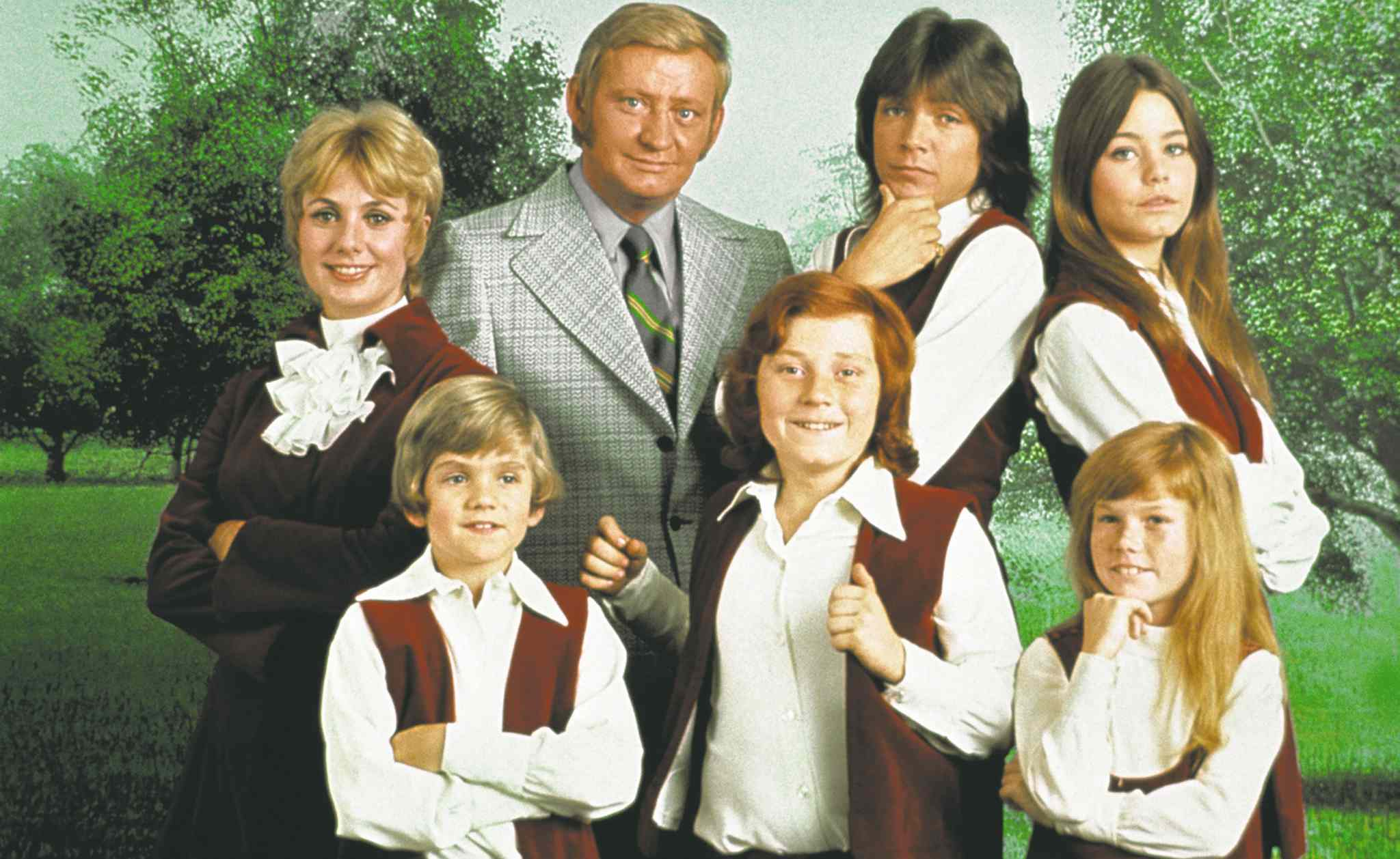 This 1970 photo released by courtesy of Sony Pictures Television shows, back row, from left, cast members, Shirley Jones, Dave Madden, David Cassidy, Susan Dey, and front row, from left, Brian Forster, Danny Bonaduce and Suzanne Crough of the television series,