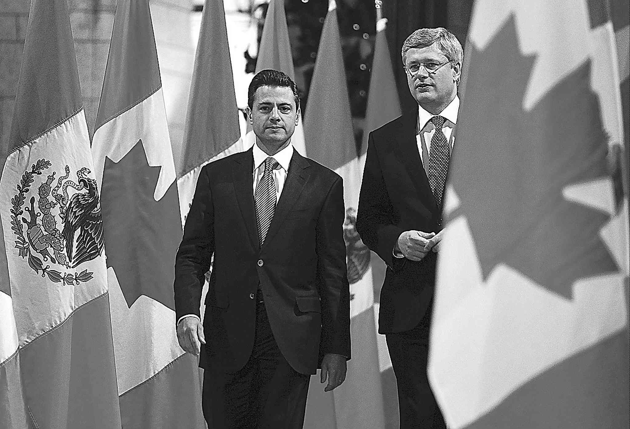 Mexican President Enrique Peña Nieto (left) and Canadian Prime Minister Stephen Harper.