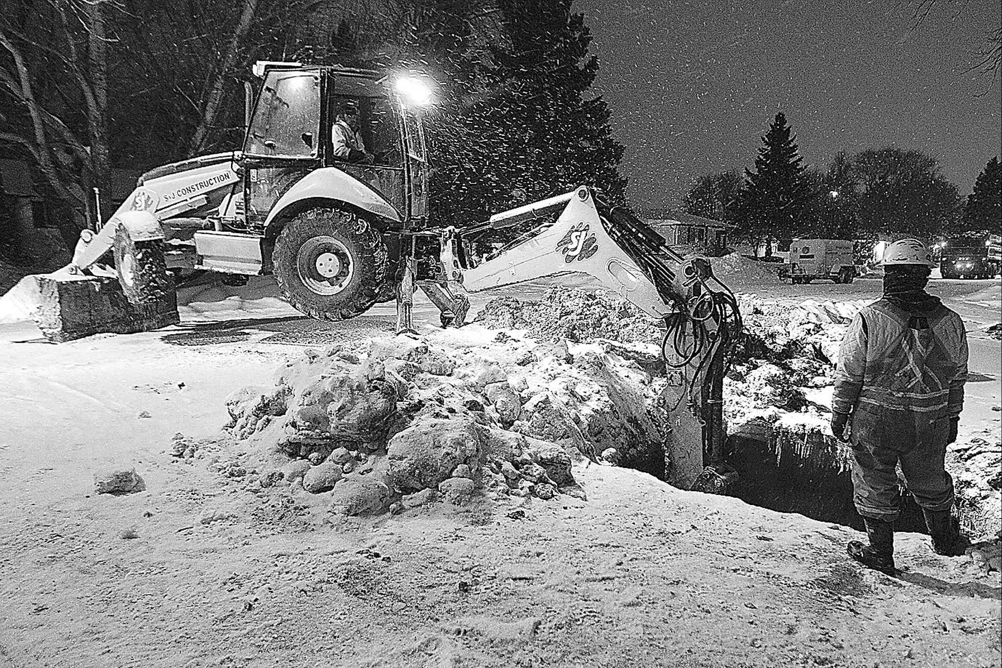 City crews repair a water-main break in Charleswood on Sunday.