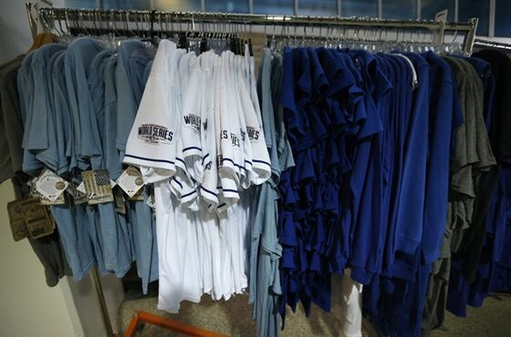 Shirts and jerseys hang on a rack in preparation for Tuesday's World Series baseball game at Kauffman Stadium in Kansas City, Mo., Monday, Oct. 20, 2014. The Kansas City Royals will host the San Francisco Giants in Game 1 of the World Series on Oct. 21. (AP Photo/Orlin Wagner)