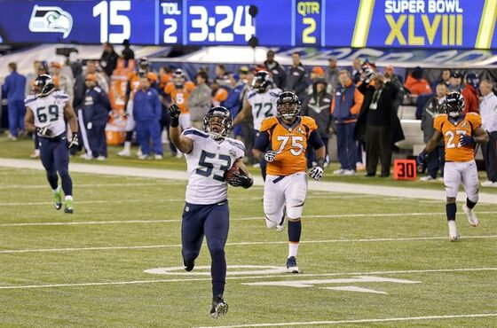 FILE- In this Feb. 2, 2014, file photo, Seattle Seahawks outside linebacker Malcolm Smith (53) reacts as he returns an interception for a touchdown against the Denver Broncos during the first half of the NFL Super Bowl XLVIII football game in East Rutherford, N.J. Slowed by injuries since the offseason, Smith is still an important part of Seattle's special teams, but he rarely sees the field on defense. (AP Photo/Gregory Bull, File)
