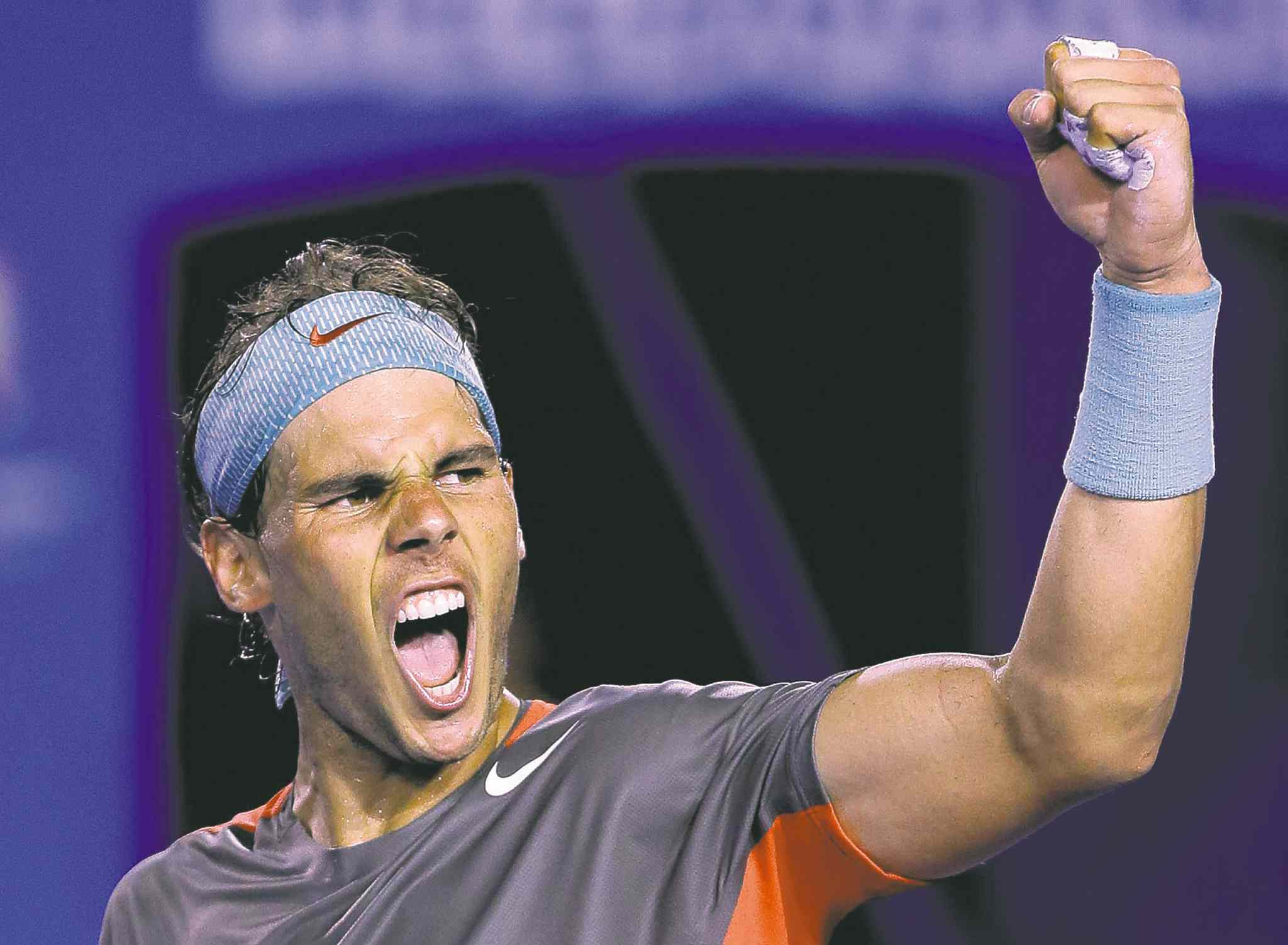 Rafael Nadal of Spain bellows in triumph after defeating Roger Federer during their Australian Open semifinal.