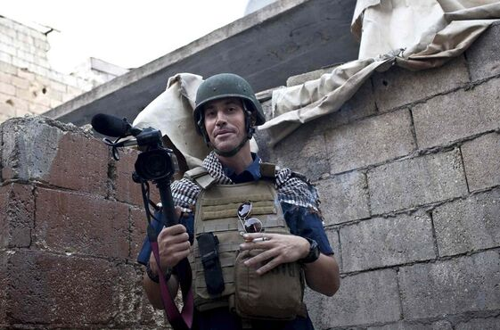 In this November 2012, file photo, American journalist James Foley is seen while covering the civil war in Aleppo, Syria. In a horrifying act of revenge for U.S. airstrikes in northern Iraq, militants with the Islamic State extremist group have beheaded Foley -- and are threatening to kill another hostage, U.S. officials say.