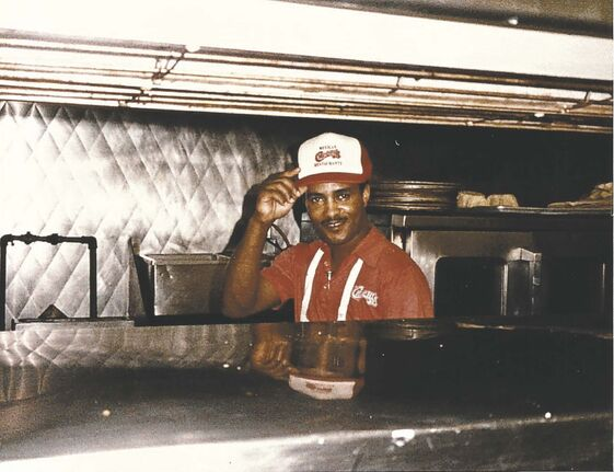 One of the cooks, only identified as Warren, tips his hat at Chi-Chi's in 1984. (Supplied)</p>
