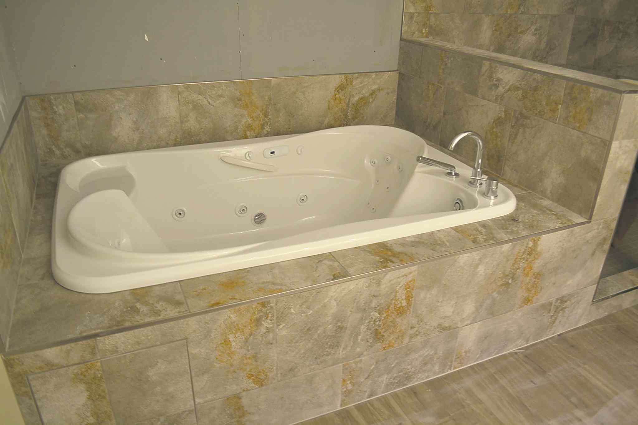 Installed Maax Crescendo jetted tub.