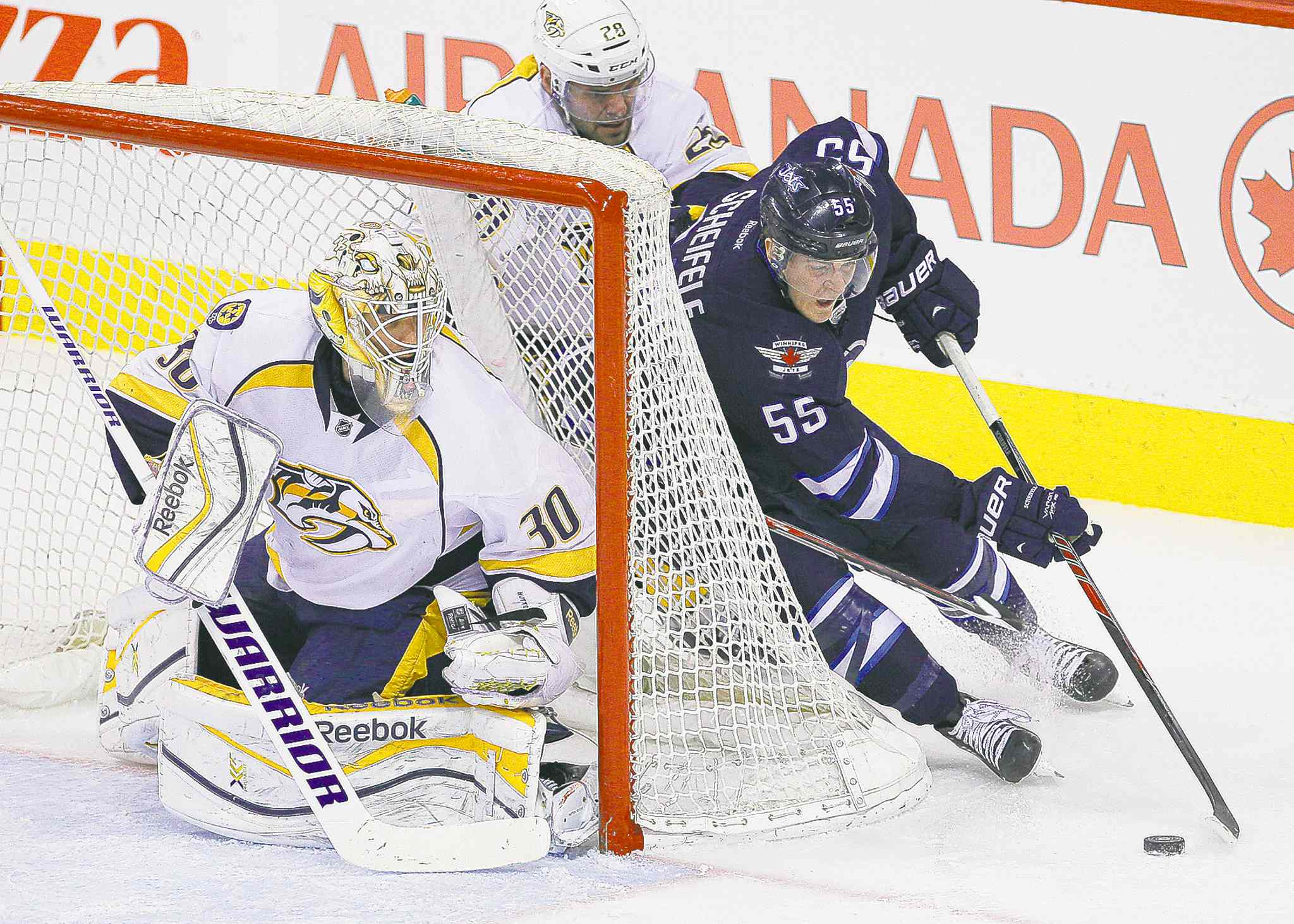 Winnipeg rookie centre Mark Scheifele (55), an emerging star, is a member of the youngest roster in the NHL.