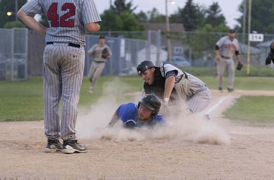 St. Boniface Legionaires' Zach Riet slides into home base during the game against Elmwood Giants at Koskie Field during the Manitoba Junior Baseball finals Thursday evening. The Giants won the championship series.