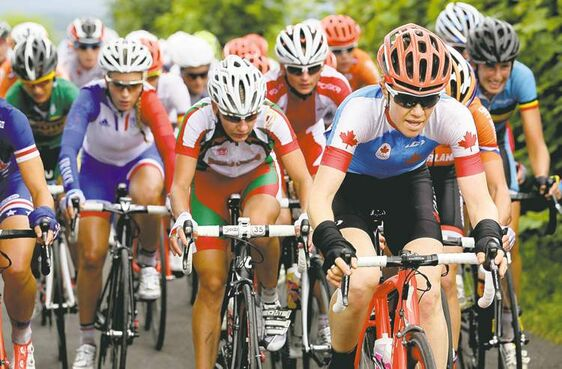 Winnipeg's Clara Hughes (right) leads the pack during the women's cycling road race final through the streets of London. She ended up in 32nd place.