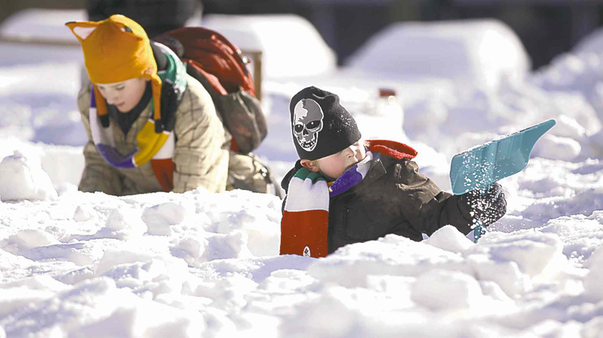 TREVOR HAGAN / WINNIPEG FREE PRESS Brothers, Ethan, 12, and Graham Wild, 5, were among those helping to construct the maze out of snow blocks at Millennium Library Park.
