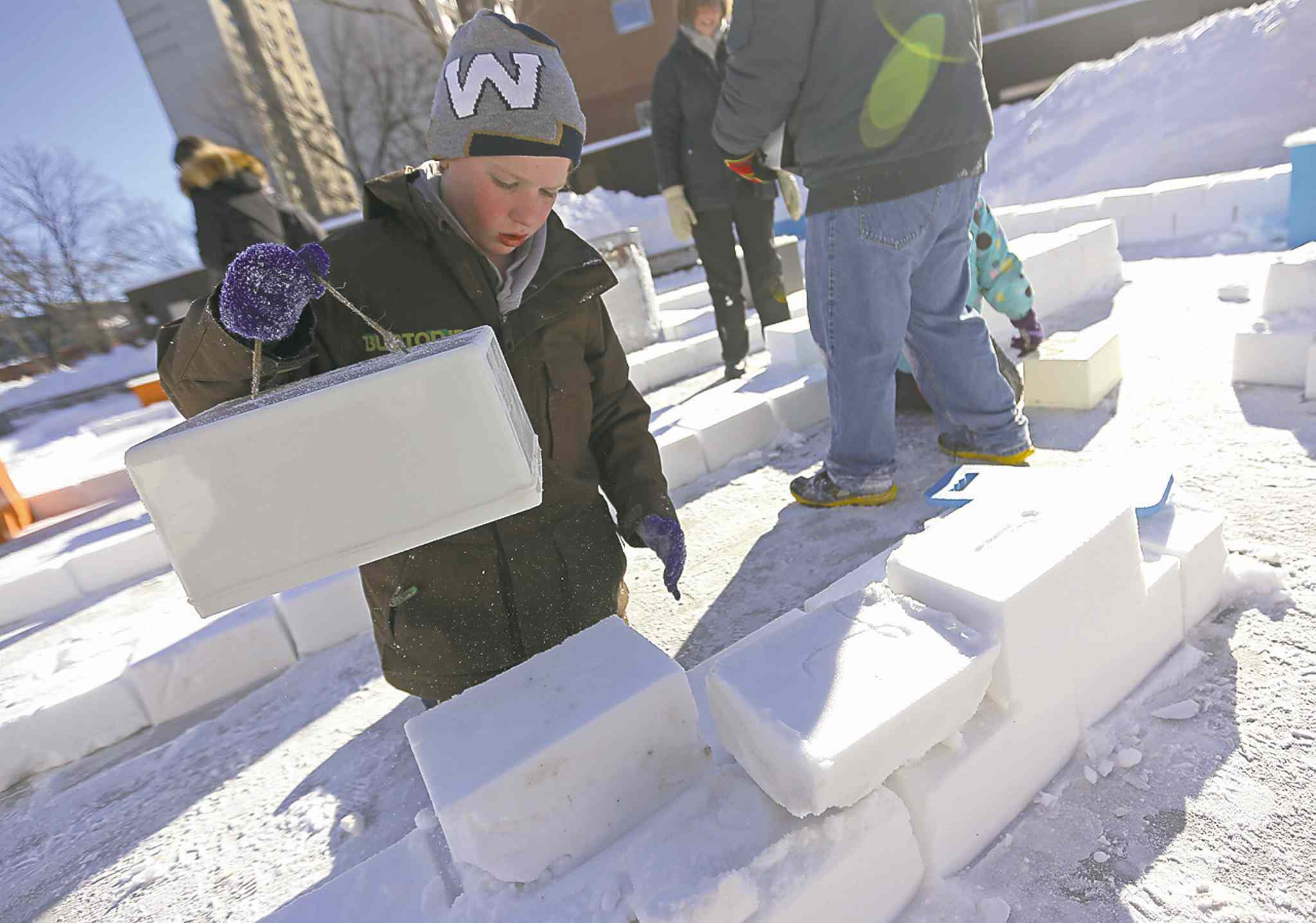 TREVOR HAGAN / WINNIPEG FREE PRESS Lenny Wilson, 8, who recently moved here from Melbourne, Australia, works on a snow block at the snow maze Saturday.