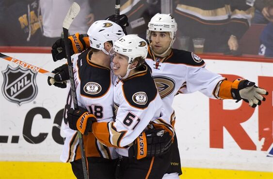 Anaheim Ducks' Tim Jackman, from left to right, Rickard Rakell, of Sweden, and Andrew Cogliano celebrate Rakell's goal against the Vancouver Canucks during the third period of an NHL hockey game in Vancouver, B.C., on Tuesday January 27, 2015. THE CANADIAN PRESS/Darryl Dyck