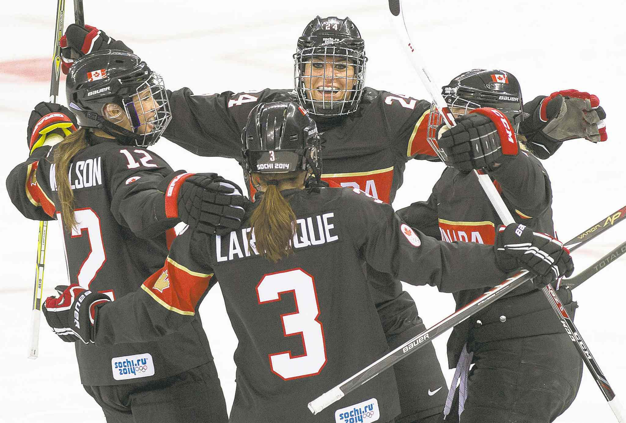 Nathan Denette / the canadian pressJocelyne Larocque of Ste. Anne, Man., celebrates her goal with Canadian teammates while facing Switzerland Saturday.
