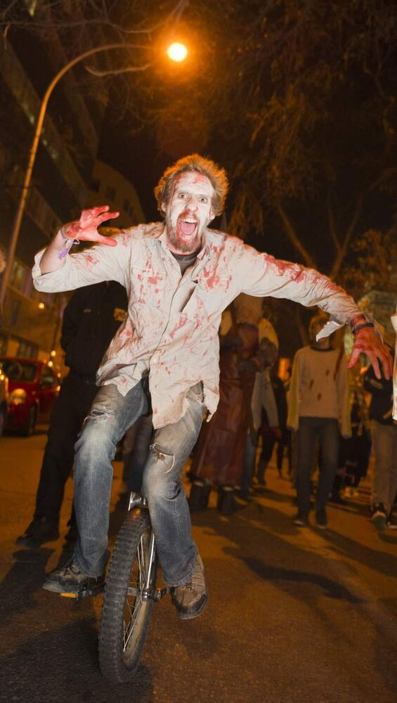 Zombie unicyclist Sean Soloway during the annual Winnipeg Zombie Walk from The Forks to The Manitoba Legislative Building Saturday night.  DAVID LIPNOWSKI / WINNIPEG FREE PRESS