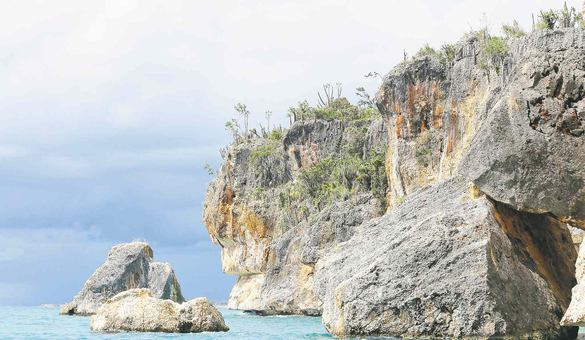 The boat ride to the beaches at Eagle Bay in Jaragua National Park straddles a cliffed coastline and threads through promintory rocks dislodged from the past earthquakes.