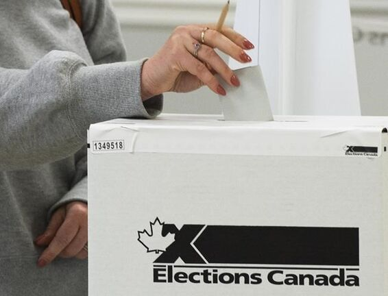 A voter casts their ballot at the advance polls in Chambly, Que., Friday, Sept. 10, 2021. Canadians will vote in a federal election Sept. 20th. THE CANADIAN PRESS/Ryan Remiorz