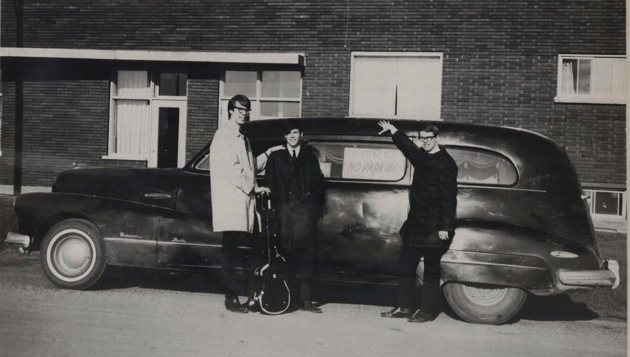 Courtesy Owen Clark</p><p>Bandmates Ken Koblun (from left), Young and Bob Clark with Young's first hearse.</p></p>