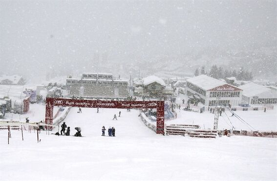 FILE - In this Dec.17, 2011 file photo, snow falls on the finish area after an alpine ski women's World Cup giant slalom in Courchevel, France. Russia's tensions with the West over Ukraine and a slump in the ruble are echoing in the French Alps, just in time for ski season. Hoteliers, taxi drivers and ski stations in France's wintertime hotspots say a tourism boom by big-spending Russians in recent years is about to melt because of Russia's economic crisis, Western sanctions and falling oil prices. (AP Photo/Marco Trovati, File)