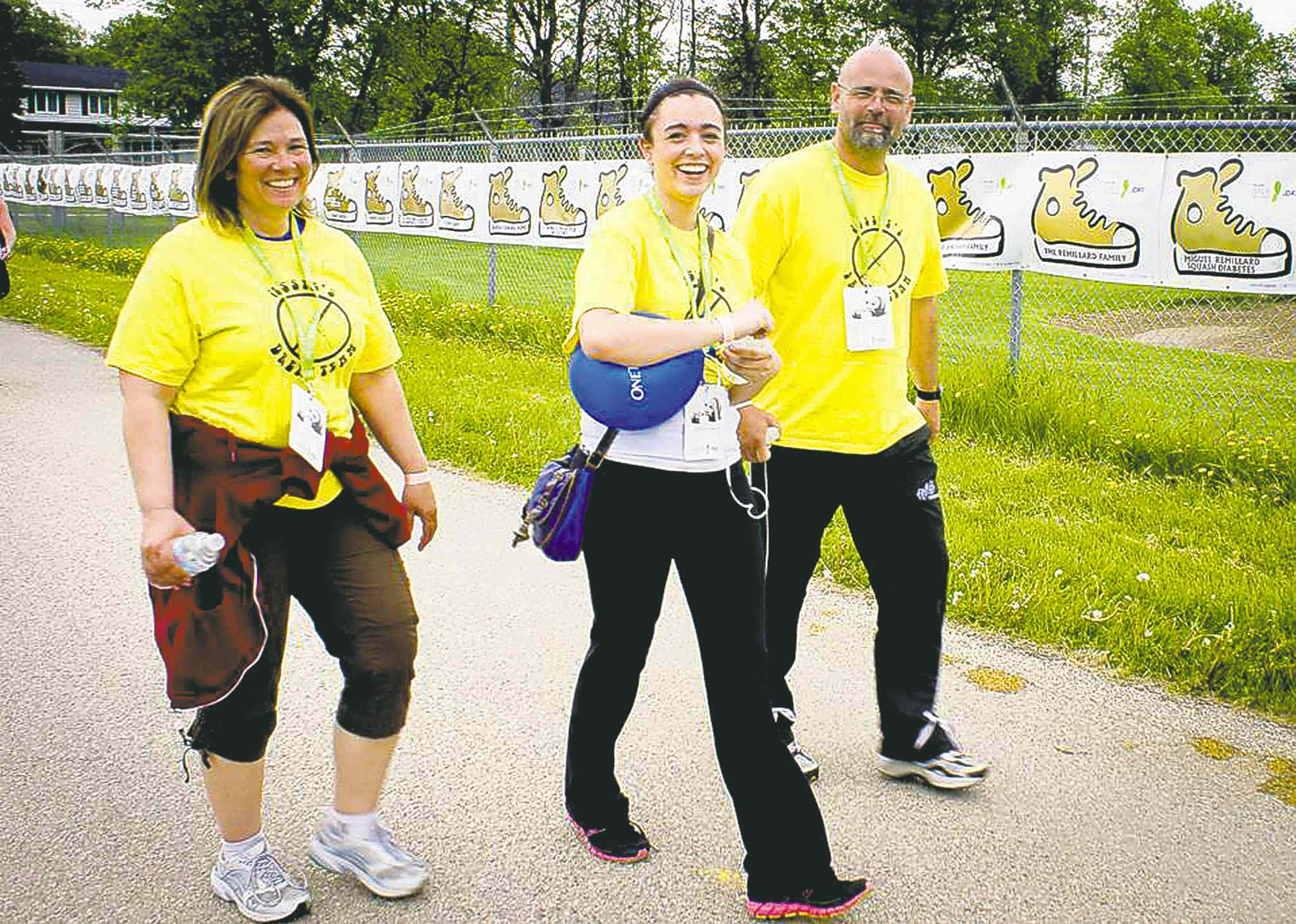 Jessica Williams (centre) and parents Tammy and Mike Williams in the 2013 Telus Walk to Cure Diabetes.