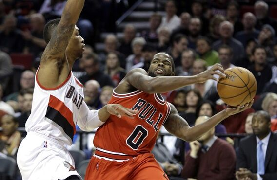 Chicago Bulls guard Aaron Brooks, right, looks to pass as Portland Trail Blazers guard Damian Lillard defends during the first half of an NBA basketball game in Portland, Ore., Friday, Nov. 21, 2014. (AP Photo/Don Ryan)
