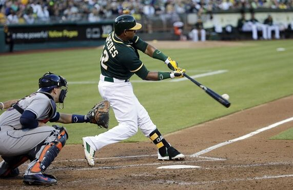 FILE - In this July 23, 2014 file photo, Oakland Athletics' Yoenis Cespedes hits a three-run home run against the Houston Astros during the second inning of a baseball game in Oakland, Calif. A person with knowledge of the trade says the Athletics have won the Jon Lester sweepstakes, acquiring the left-hander along with outfielder Jonny Gomes from the Red Sox for slugging outfielder Yoenis Cespedes before Thursday's, July 31, 2014, trade deadline. The person spoke on condition of anonymity because neither club announced the deal. (AP Photo/File)